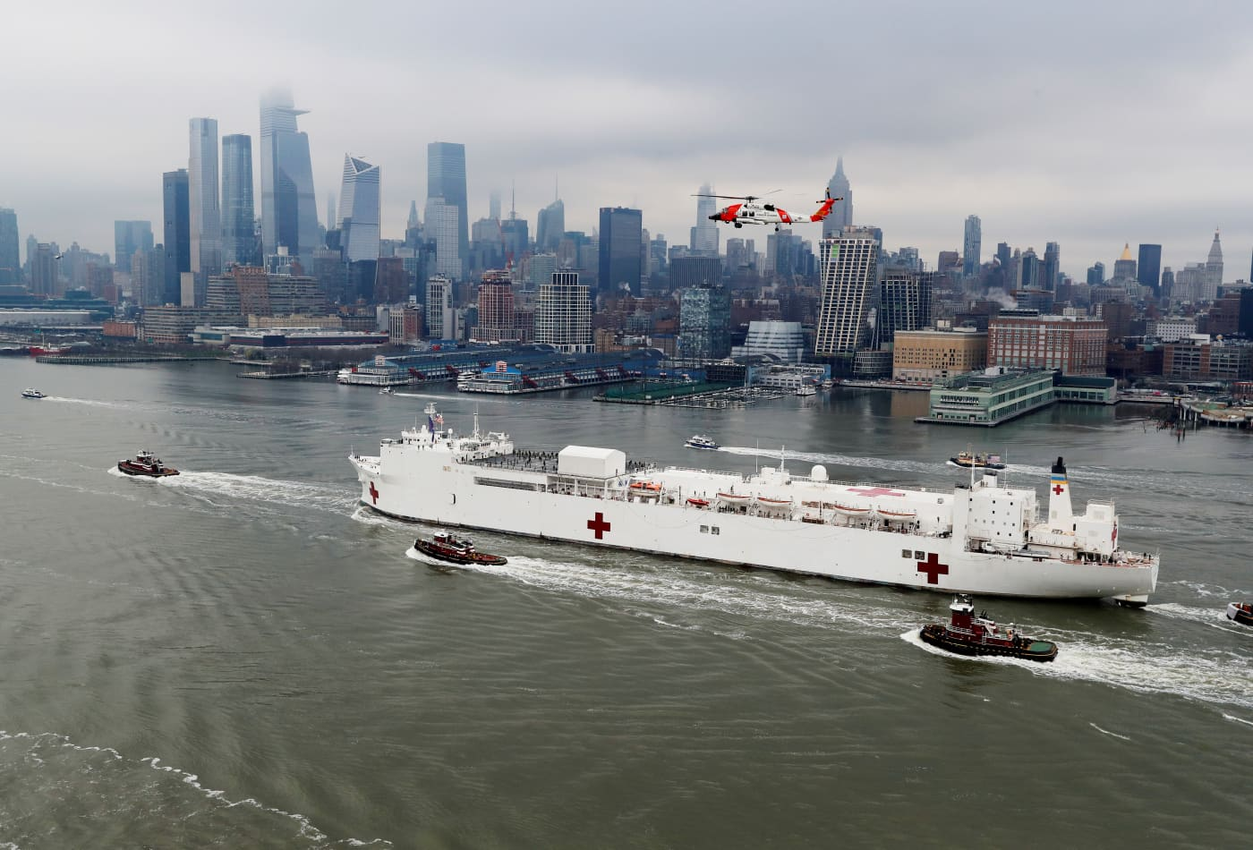 Iconic photos of the USNS Comfort arriving in New York, providing a glimmer of hope