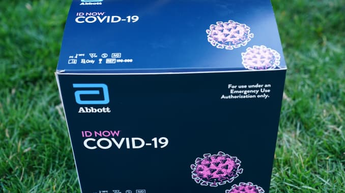 A box containing a 5-minute test for COVID-19 from Abbott Laboratories is pictured during the daily briefing on the novel coronavirus, COVID-19, in the Rose Garden of the White House in Washington, DC, on March 30, 2020.