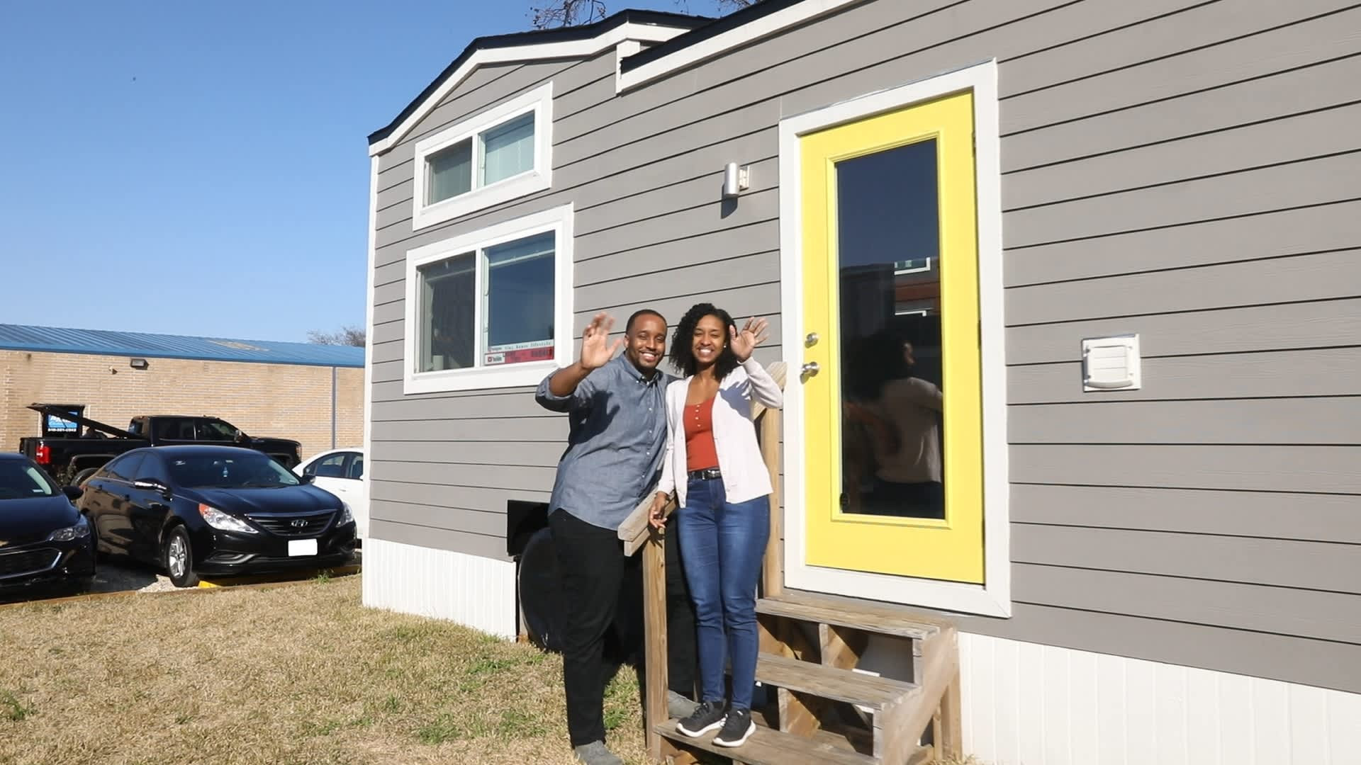 Marek and Kothney-Issa in front of their home in Lake Dallas, Texas. The couple live in a tiny home community.