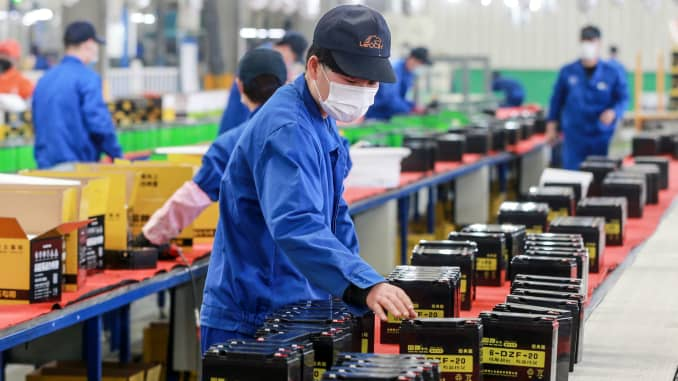 This photo taken on March 30, 2020 shows an employee working on a battery production line at a factory in Huaibei in China's eastern Anhui province.