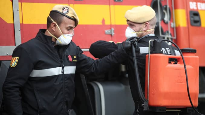 Two soldiers of the Military Emergency Unit are seen carrying material to disinfect the nursing and day centre ORPEA Sanchinarro for the second time to stop coronavirus infection on April 01, 2020 in Madrid, Spain.