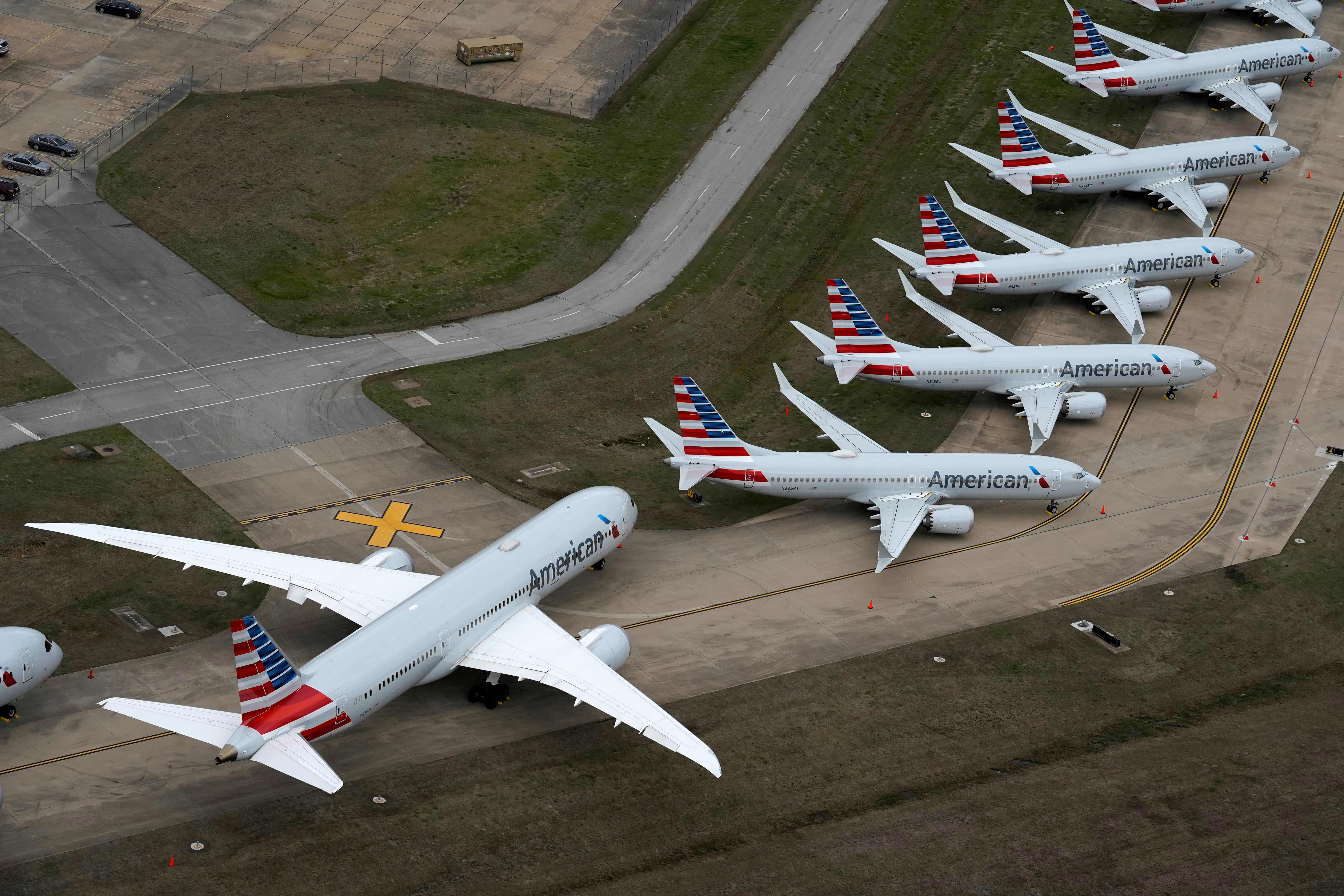 American Airlines cuts summer international flights by 60% as demand suffers