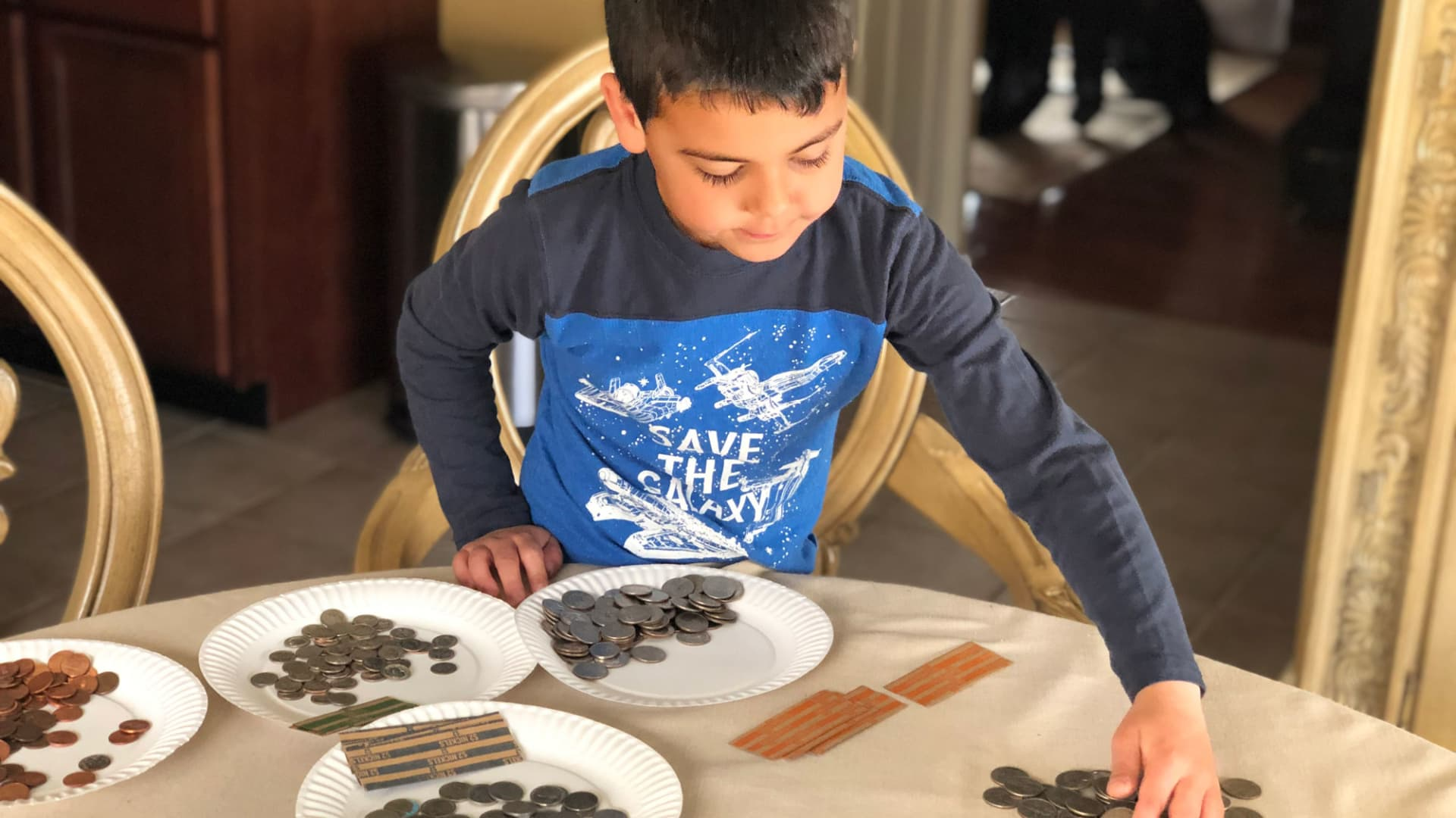 Sorting coins is one way of teaching kids about money.