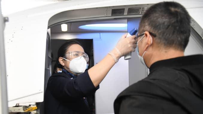 GP: Coronavirus Wuhan lifts restrictions temperature boarding flight