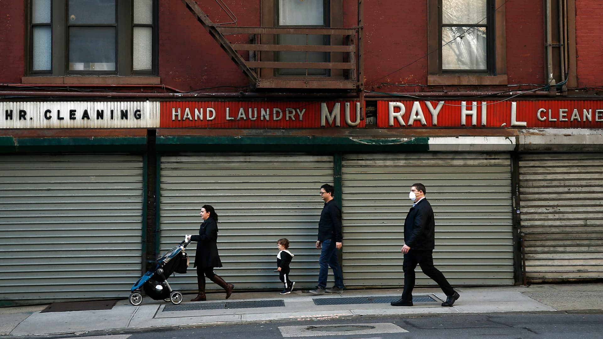 Pedestrians walk past closed shops along Lexington Avenue amid the coronavirus pandemic on April 7, 2020 in New York City.