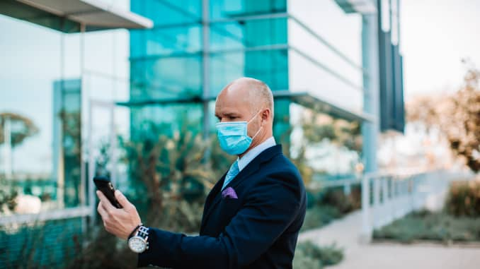 GP: Essential businessman with facemask during COVID-19