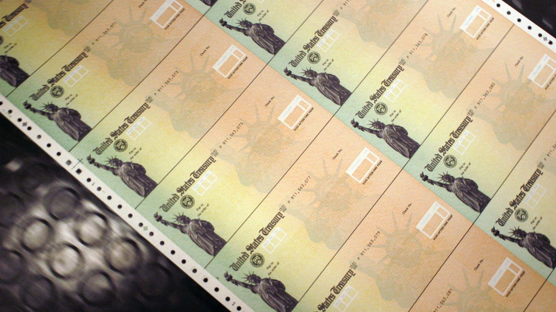 Blank Social Security checks are run through a printer at the U.S. Treasury printing facility February 11, 2005 in Philadelphia, Pennsylvania.