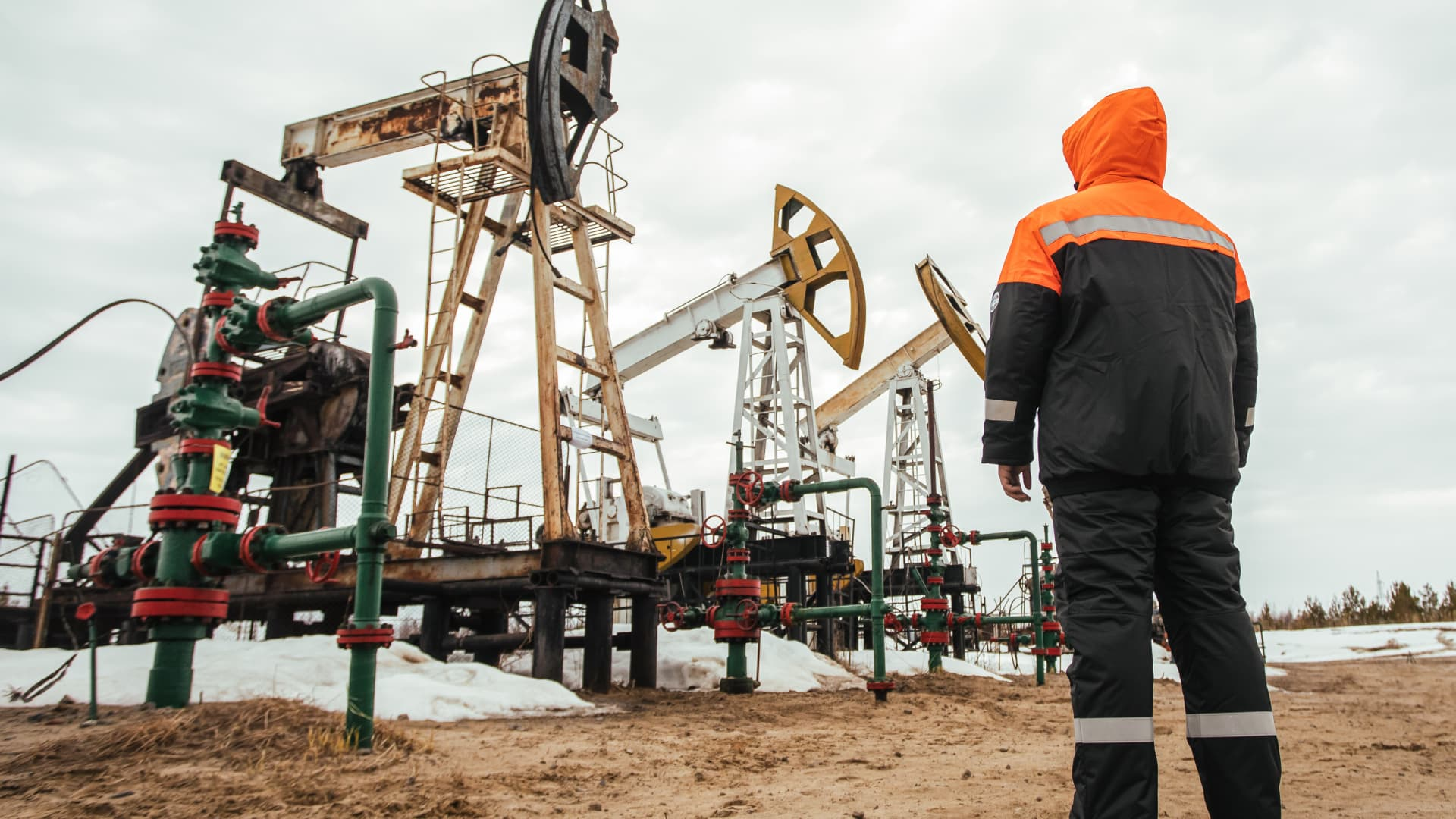 A Surgutneftegas worker near pumpjacks in Surgut Region of the Khanty-Mansi Autonomous Area - Yugra, in the West Siberian petroleum basin.