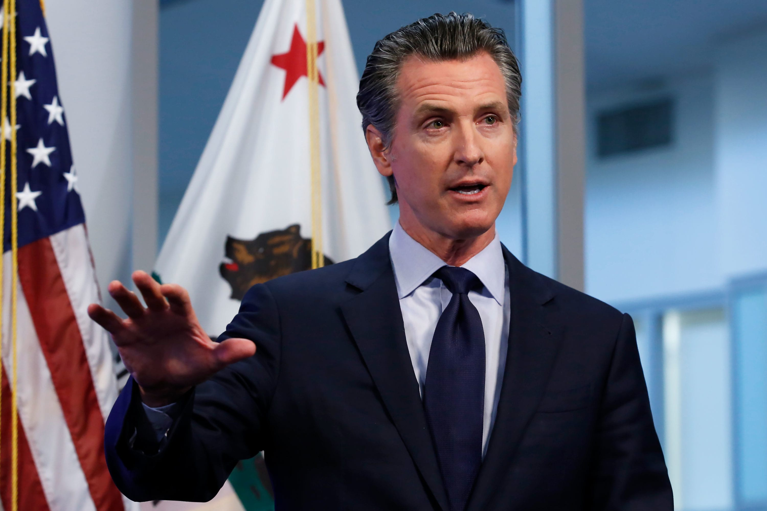 California Gov. Gavin Newsom says some businesses will reopen Friday, with  conditions