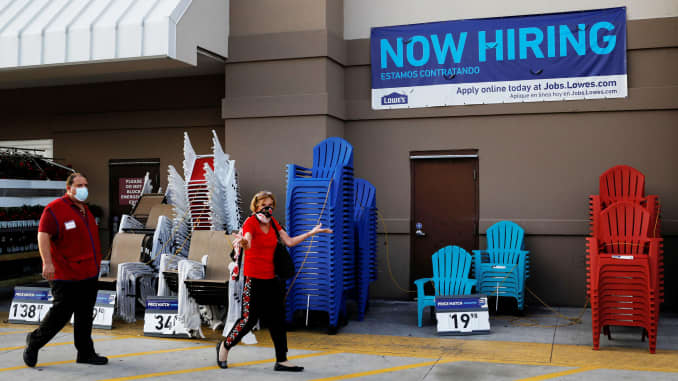 """A """"Now Hiring"""" sign advertising jobs at Lowe's is seen as the spread of the coronavirus disease (COVID-19) continues, in Homestead, Florida, U.S., April 17, 2020."""