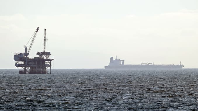An offshore oil platform is seen with a tanker in the distance on April 20, 2020 in Huntington Beach, California.