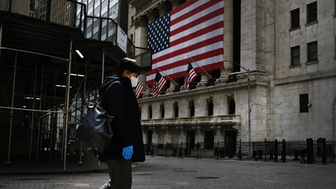 Wall Street and much of the Financial District stands empty as the coronavirus keeps financial markets and businesses mostly closed on April 20, 2020 in New York City.
