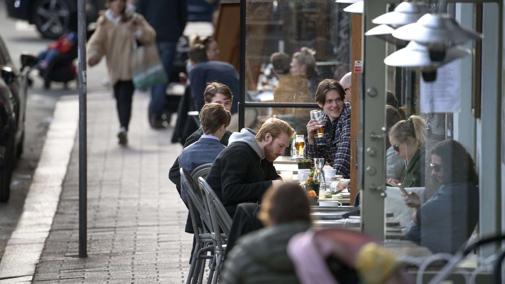 People enjoy themselves at an outdoor restaruant, amid the coronavirus disease (COVID-19) outbreak, in central Stockholm, Sweden, on April 20, 2020.