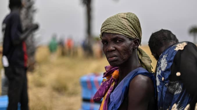 Villagers fetch gunny bags containing food rations in Ayod county, South Sudan, where World Food Programme carried out a food drop of grain and supplementary aid on February 6, 2020.