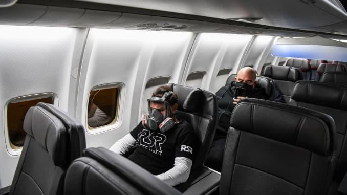 GP: Coronavirus air travle passenger in gas mask