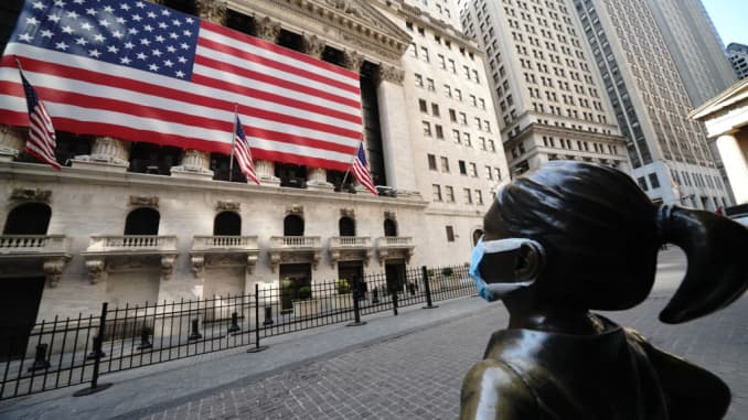 A view of the fearless girl wearing a mask in front of the New York Stock Exchange in New York City USA during coronavirus pandemic on April 25, 2020.