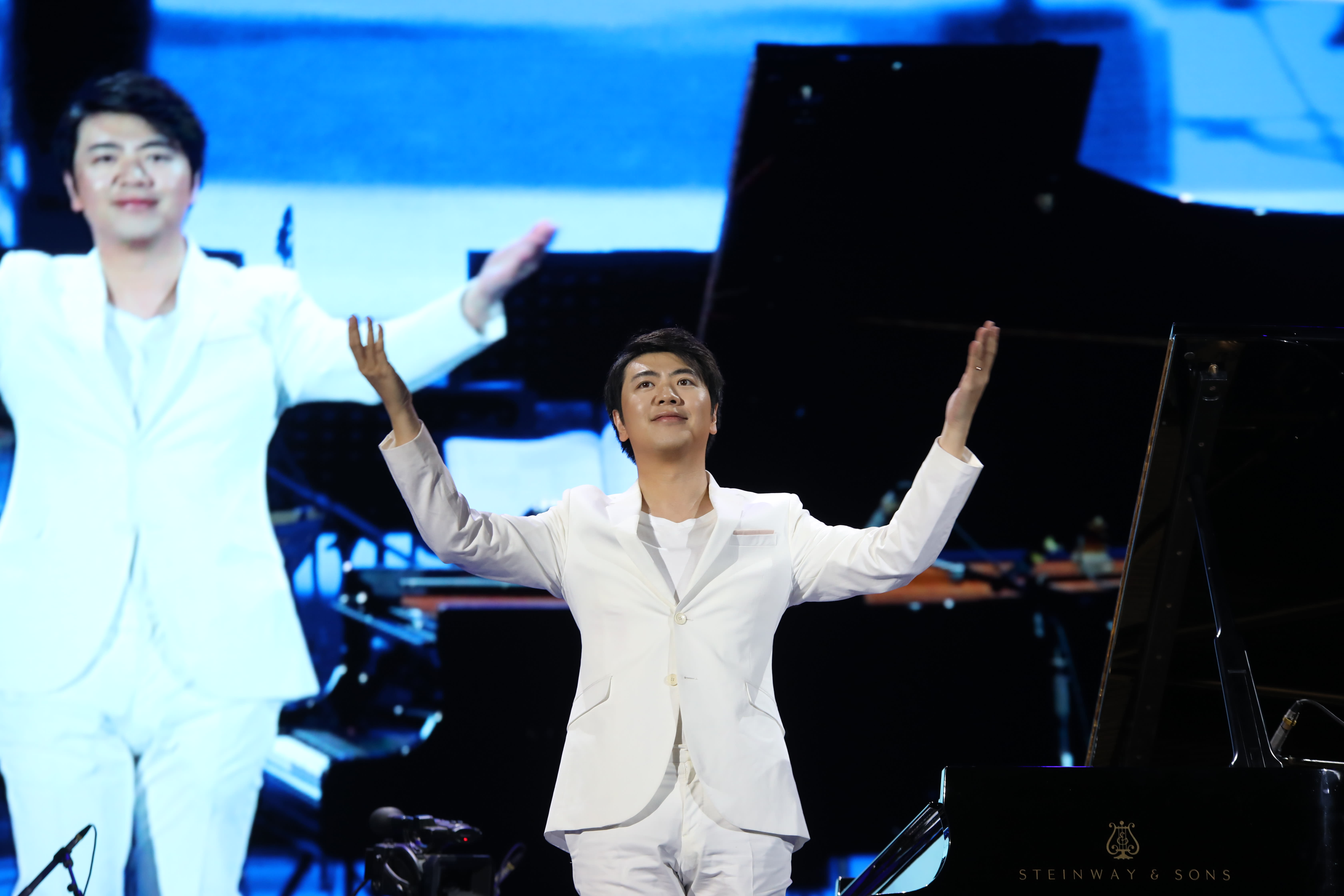 Pianist Lang Lang says the coronavirus is 'beyond imagination,' but welcomes signs of a return to normal