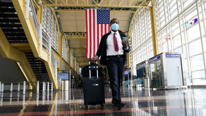 A passenger walks through Reagan National airport as the novel coronavirus (COVID-19) pandemic continues to keep airline travel at minimal levels and the U.S. economy contracts in the first quarter at its sharpest pace since the Great Recession, in Washin