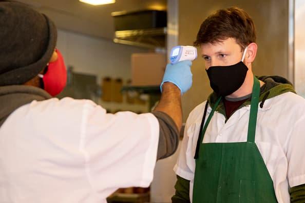 The coronavirus pandemic has created a new job: temperature taker