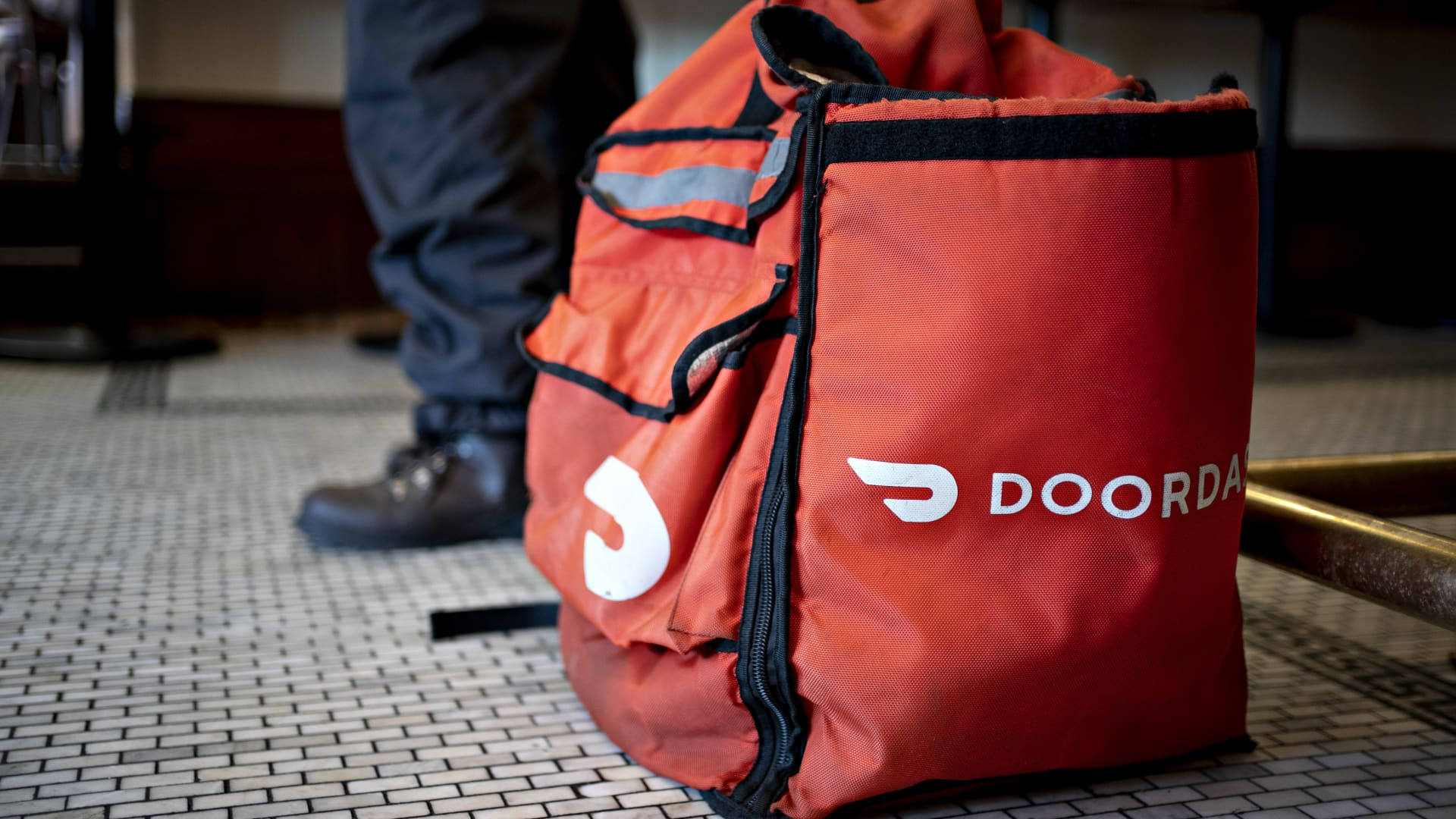 A DoorDash Inc. delivery bag sits on the floor at Chef Geoff's restaurant in Washington, D.C.