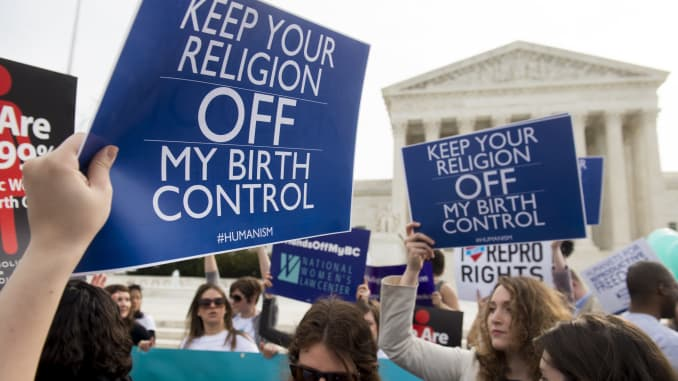 Supporters of women's health rally outside the Supreme Court in Washington, DC, March 23, 2016, as the Court hears oral arguments in 7 cases dealing with religious organizations that want to ban contraceptives from their health insurance policies on relig