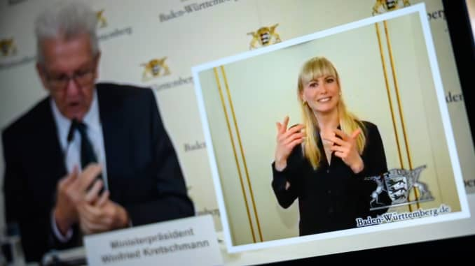 Franziska Paschek, sign language interpreter, translates what was said during an internet-streamed coronavirus press conference of a German state government official.