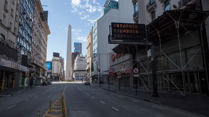 Signal hanging with a message in Spanish that reads 'protect your mouth with a mask' in the empty Buenos Aires obelisk landscape during the government-ordered lockdown on May 01, 2020 in Buenos Aires, Argentina.