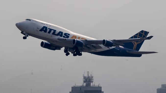 A Boeing 747 cargo freighter belonging to the Atlas Air flies into the clouds after lifting off from Hong Kong International Airport, on 23 October 2017, in Hong Kong, Hong Kong.