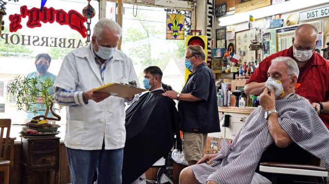 Men receive haircuts as social distancing guidelines to curb the spread of the coronavirus disease (COVID-19) are relaxed at Doug's Barber Shop in Houston, Texas, May 8, 2020.