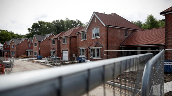 New-build residential homes are pictured during construction at a housing development, stalled due to the COVID-19 pandemic, in Riseley near Reading on May 1, 2020.