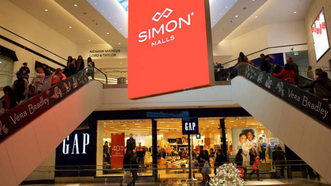 Shoppers ascend and descend escalators at the King of Prussia Mall, owned by Simon Property Group, United State's largest retail shopping space, in King of Prussia, Pennsylvania.