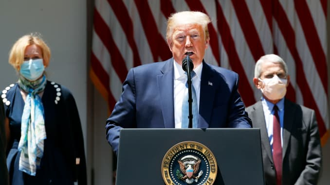 President Donald Trump speaks about the coronavirus in the Rose Garden of the White House, Friday, May 15, 2020, in Washington. Dr. Anthony Fauci, director of the National Institute of Allergy and Infectious Diseases, right, and White House coronavirus re