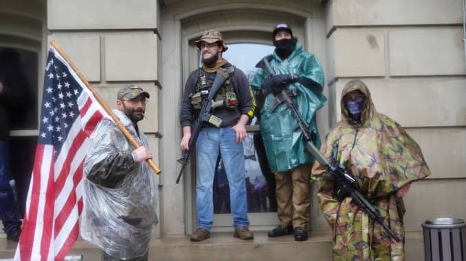 Armed demonstrators attend a rally in front of the Michigan state capital building to protest the governor's stay-at-home order on May 14, 2020 in Lansing, Michigan.
