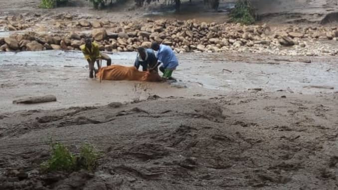 Residents in the county of West Pokot, Kenya, retrieve a body after a recent mudslide.