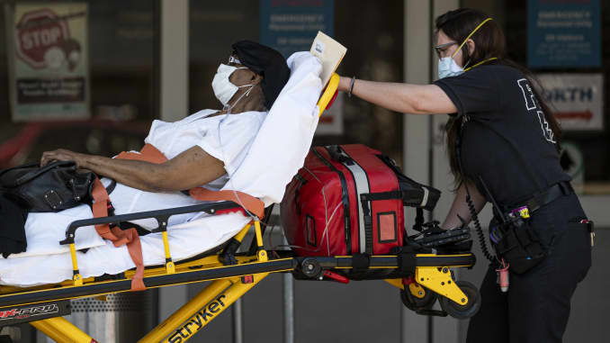 Medical workers transport a patient outside a special Covid-19 area at Maimonides Medical Center in Brooklyn, New York, on May 17.