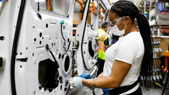 Ford factory worker in face mask