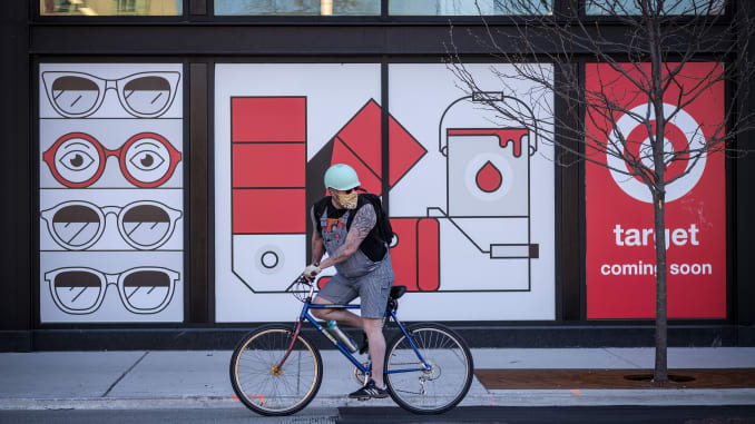 A cyclist wearing a protective mask passes the future site of a Target Corp. store in Chicago, Illinois, U.S., on Thursday, May 7, 2020.