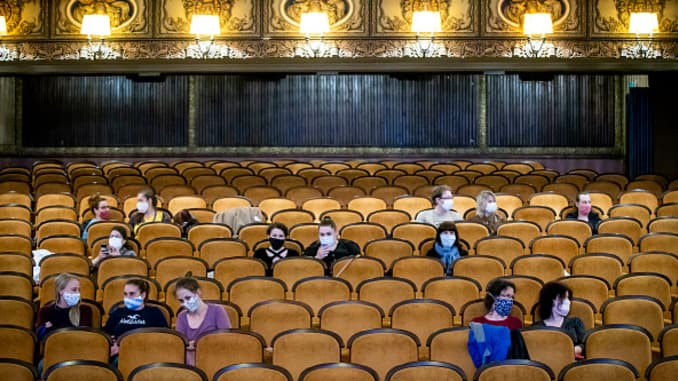 Customers wearing protective masks sit apart in observance of social distancing measures inside a movie theater as the Czech government lifted more restrictions allowing cinemas to re-open on May 11, 2020, in Prague, Czech Republic.