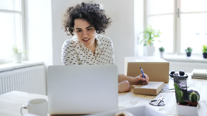 best credit cards for big shipping budgets, best credit cards for working from home, person working from home office