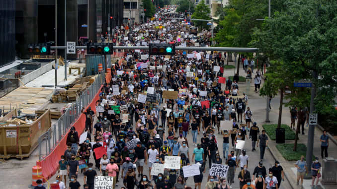 Protesters march during a demonstration over the death of George Floyd, a black man who died after a white policeman kneeled on his neck for several minutes in Houston, Texas on May 29, 2020.