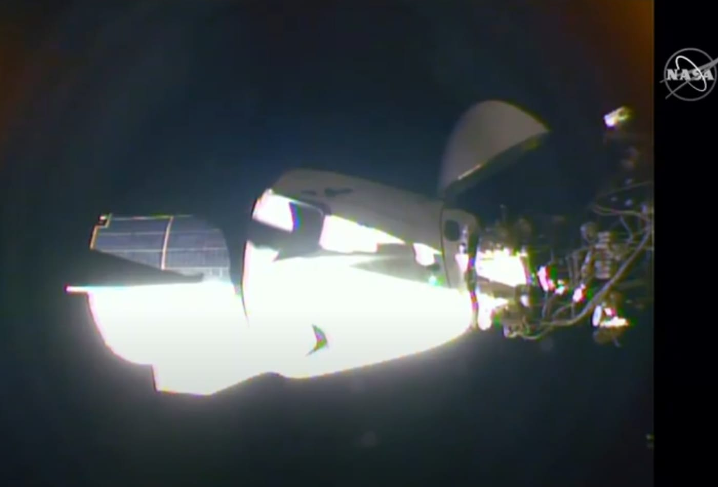 SpaceX's Crew Dragon capsule carrying NASA astronauts docks with the International Space Station