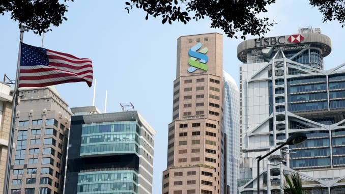 Standard Chartered headquarters and a HSBC building are pictured on March 16, 2020 in Hong Kong.