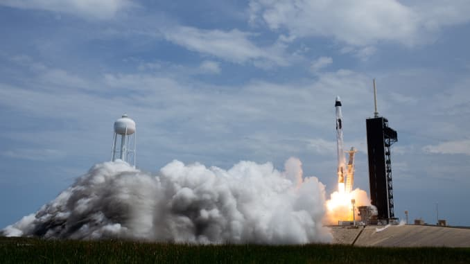 A SpaceX Falcon 9 rocket carrying the company's Crew Dragon spacecraft is launched on the Demo-2 mission with NASA astronauts Robert Behnken and Douglas Hurley onboard.