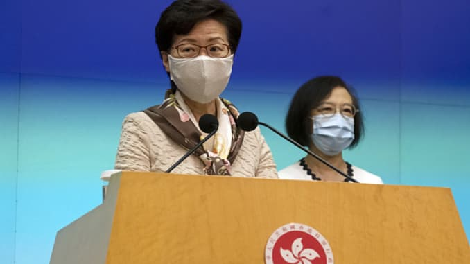 Carrie Lam, Hong Kong's chief executive, left, speaks while wearing a protective mask as Sophia Chan, Hong Kong's secretary for food and health, listens during a news conference in Hong Kong on Tuesday, June 2, 2020.