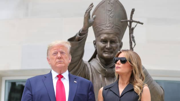 U.S. President Donald Trump and first lady Melania Trump pose during a visit to the Saint John Paul II National Shrine in Washington, U.S., June 2, 2020.