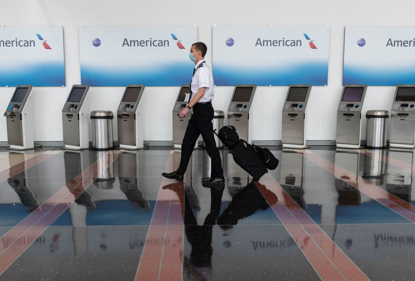 American Airlines warns 25,000 employees about potential job cuts as coronavirus continues to sap demand