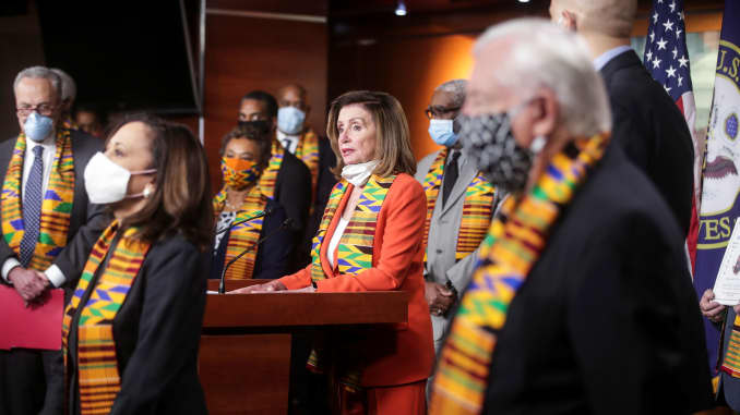 U.S. House Speaker Nancy Pelosi (D-CA) stands with Congressional Democrats as she addresses a news conference to unveil legislation to combat police violence and racial injustice after weeks of protests against racial inequality in the aftermath in Minneapolis police custody of George Floyd, at the U.S. Capitol in Washington, U.S., June 8, 2020.
