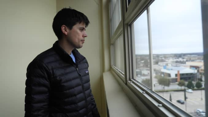 Terrence Bilodeau looks out the window at one of his many rental properties.