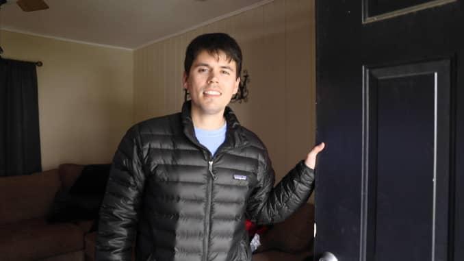 Terrence Bilodeau opens the door at one of his rental properties.