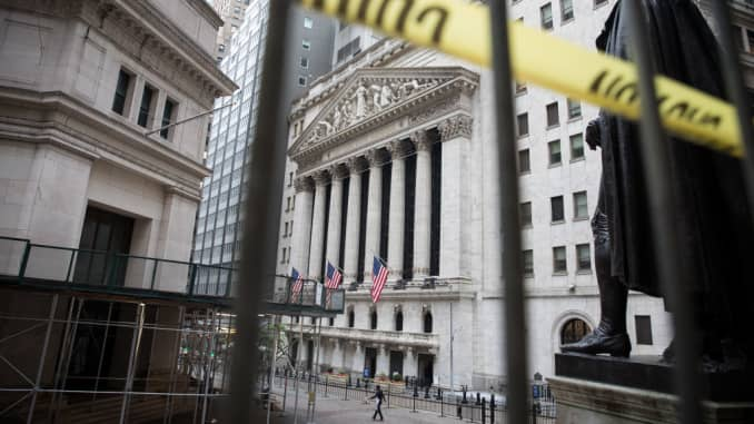 A pedestrian passes in front of the New York Stock Exchange (NYSE) in New York, U.S., on Wednesday, June 3, 2020.